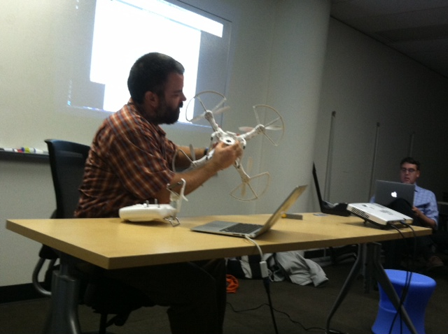 Aaron showing us his quadcopter, so to speak